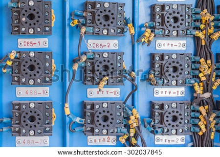 A row of switched electrical circuit breakers - stock photo