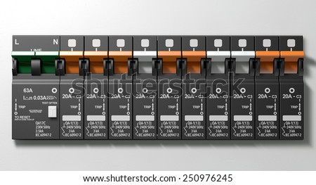 A row of switched on household electrical circuit breakers on a wall panel