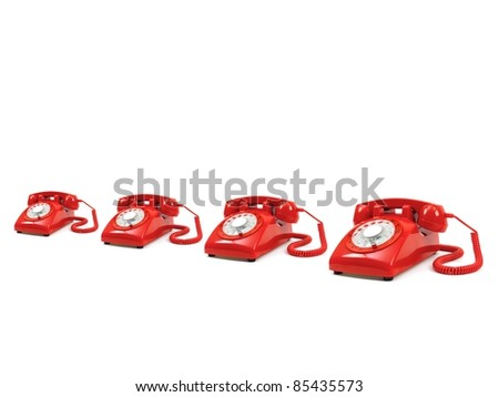 A row of telephones isolated against a white background - stock photo