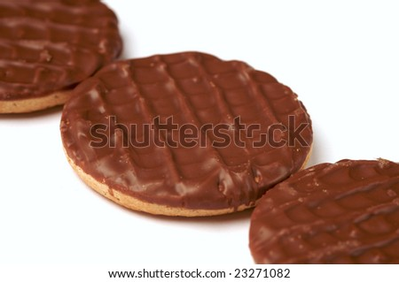 A row of three chocolate biscuits