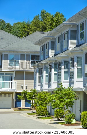 A row of townhouses in Vancouver, British Columbia, Canada. Residential townhouses on sunny day. - stock photo