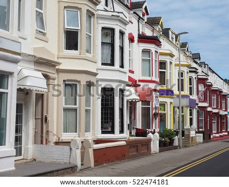 A row of traditional English terraced houses