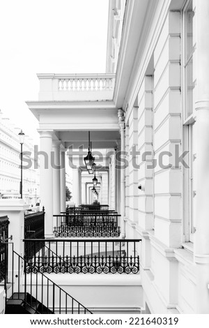 A row of typical Victorian facades found in the better living areas in London - creative black and white approach - stock photo
