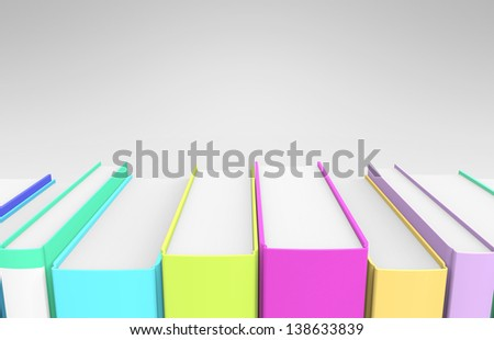 A row of very colorful books on a grey background.