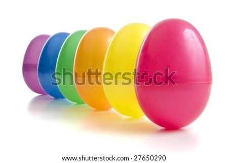 a row of vibrant coloured plastic easter eggs - stock photo