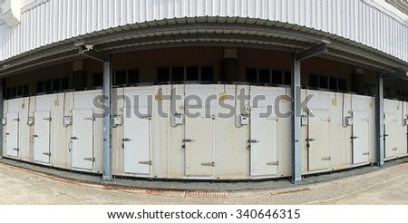 A row of walk-in refrigerators and freezer at a commercial cold storage facility  - stock photo