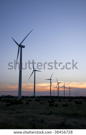 A row of wind towers on the range. - stock photo