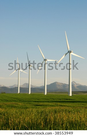 A row of windmills on plain at pincher creek, alberta, canada. These wind turbines make pincher creek the wind energy capital of canada.