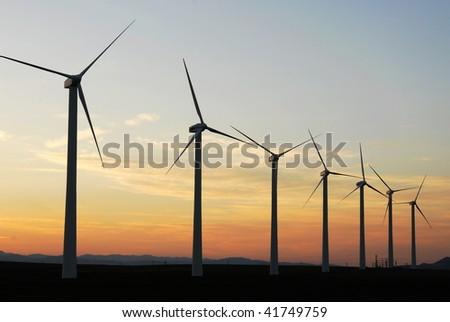 A row of windmills on prairie at pincher creek, alberta, canada. These wind turbines make pincher creek the wind energy capital of canada. - stock photo