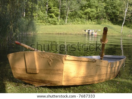 A rowing boat by a beautiful pond in Vermont - stock photo