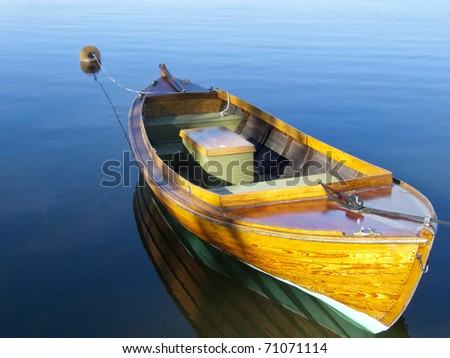 A rowing boat moored at the Nynashamn's dock in Sweden - stock photo