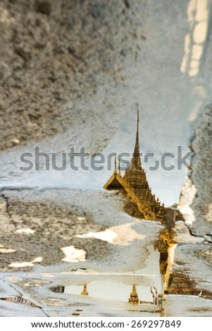A Royal Palace Building Reflecting in a puddle, Bangkok, Thailand - stock photo