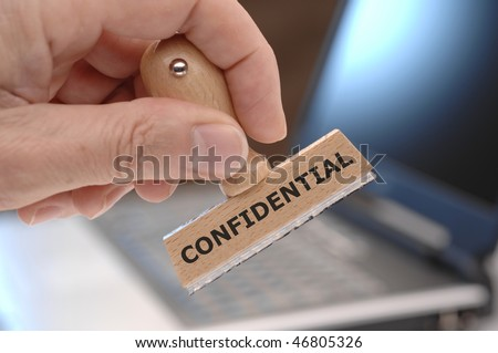 a rubber stamp with inscription CONFIDENTIAL - stock photo