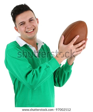 A rugby player in a green shirt holding a rugby ball, isolated on white - stock photo
