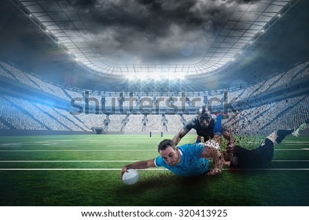 A rugby player scoring a try against rugby stadium - stock photo