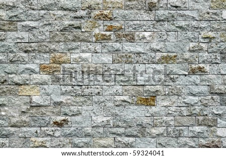 A rugged granite wall surface. - stock photo