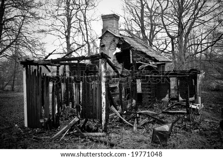 A ruin house out in the woods, burned down - stock photo