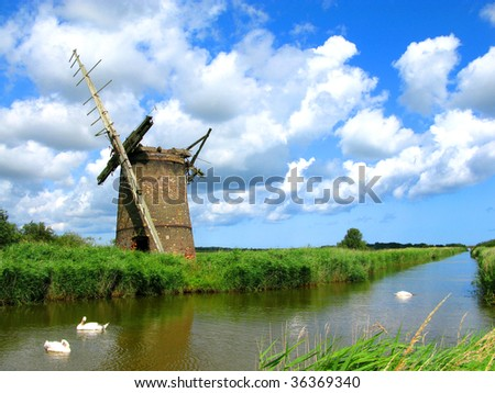 A Ruined Windmill in the Norfolk Broads England - stock photo