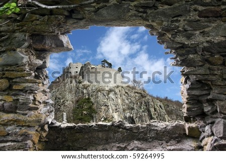 A ruins fort is seen from another ruins - stock photo