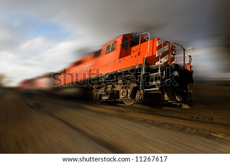 A runaway freight train with wheels of the ground (added motion blur) - stock photo