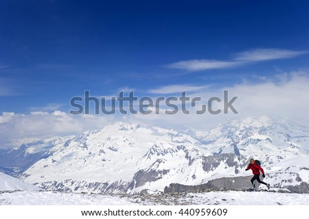A Runner Running Across High Altitude Mountains and Glaciers.