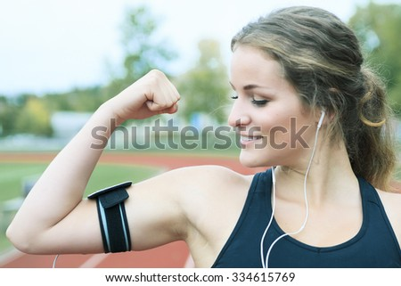 A Runner woman jogging on a field outdoor shot - stock photo