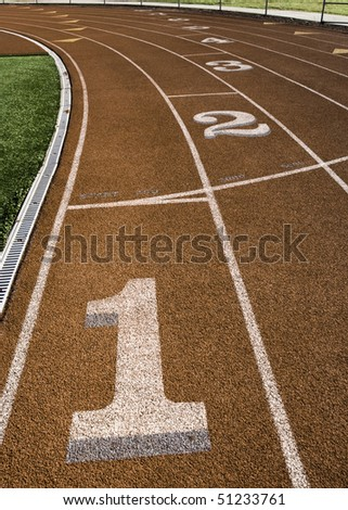 A running track view from the starting position one. - stock photo