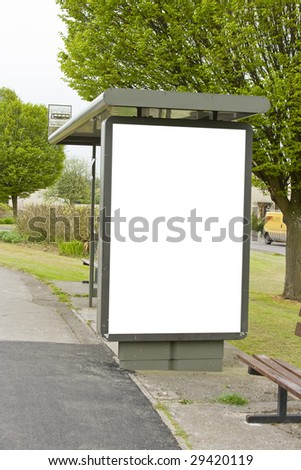 A rural bus stop with a blank poster for copy space