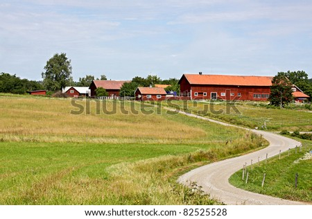 A rural road to a farm in Sweden. farm - stock photo