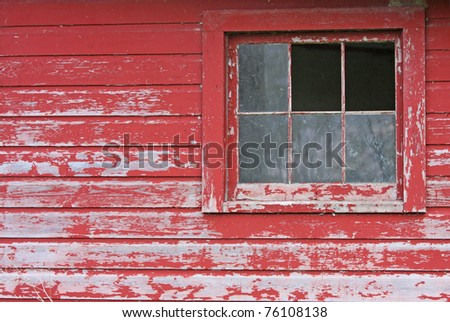 A Rustic Aged Barn with Broken Windows - stock photo