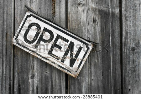 """A rustic """"open"""" sign. - stock photo"""