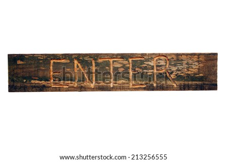 "A rustic wood ""enter"" sign, engraved by hand on aged and weathered wood.  Photograph of an actual sign; not a special effect.  Isolated on a white background with generous copyspace. - stock photo"