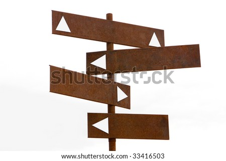 A Rusty Brown Arrow Directional Sign Post - stock photo