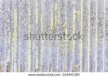 A rusty corrugated iron metal dark toned texture background - stock photo
