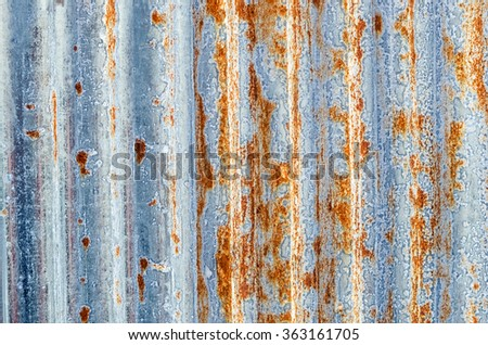 A rusty corrugated iron metal texture. - stock photo