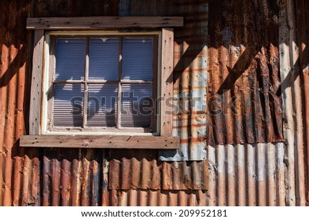 A rusty corrugated metal shed