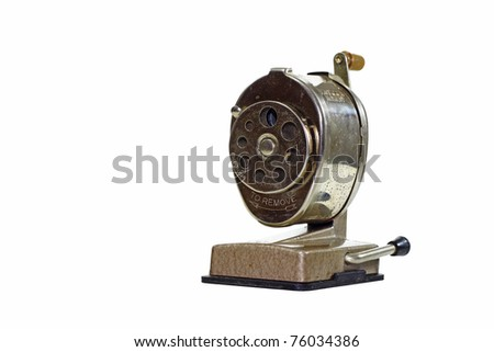 A rusty dirty old vintage antique vacuum mounted hand powered pencil sharpener isolated on white with room for your text. - stock photo