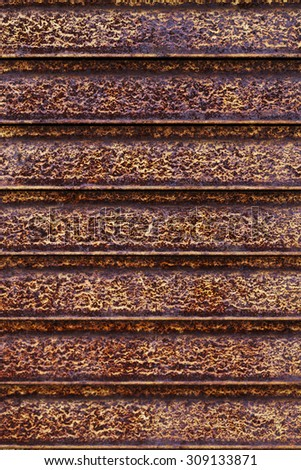 a rusty metal texture of horizontal lines - stock photo