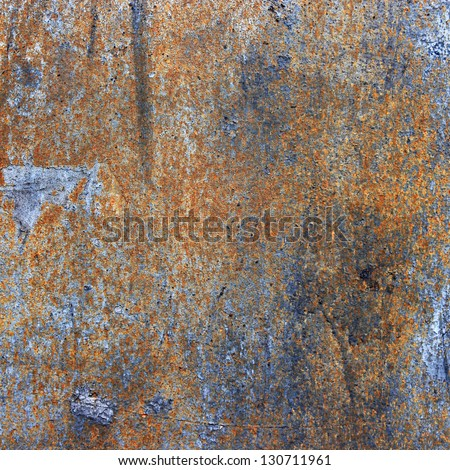 A rusty old metal plate with cracked black gloss paint. - stock photo