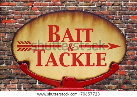 A rusty old retro arrow sign with the text Bait and Tackle - stock photo