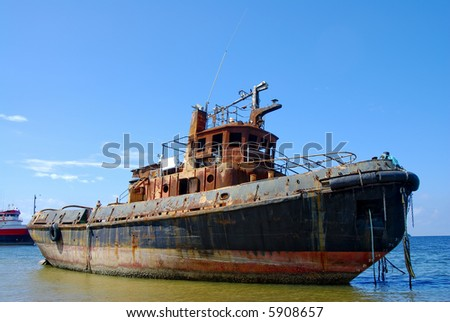 A rusty trawler wreck ,Chaguaramas Trinidad - stock photo