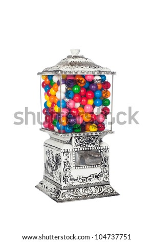 A 1950's retro vintage candy machine isolated on white. - stock photo