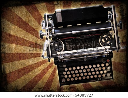 A 1900's typewriter on a grunge background - stock photo