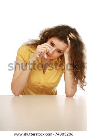 A sad beautiful woman crying - stock photo