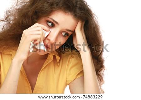A sad beautiful woman crying, closeup - stock photo
