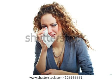 A sad beautiful woman crying , isolated on white background - stock photo