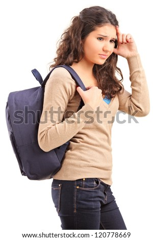 A sad female teenager with a school bag on her back posing isolated on white background - stock photo