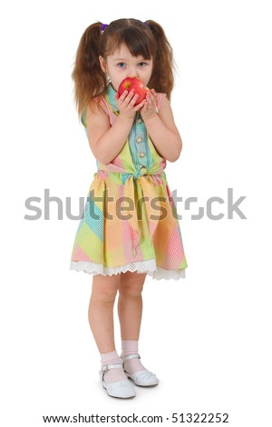 A sad little girl to eat the apple while standing on a white background - stock photo