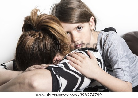A sad mother consoling by his child - stock photo