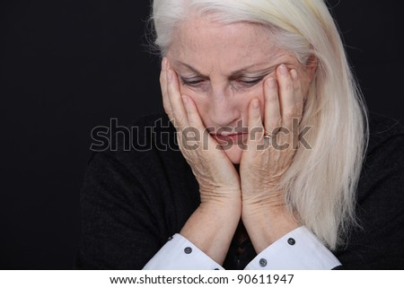 A sad old lady. - stock photo